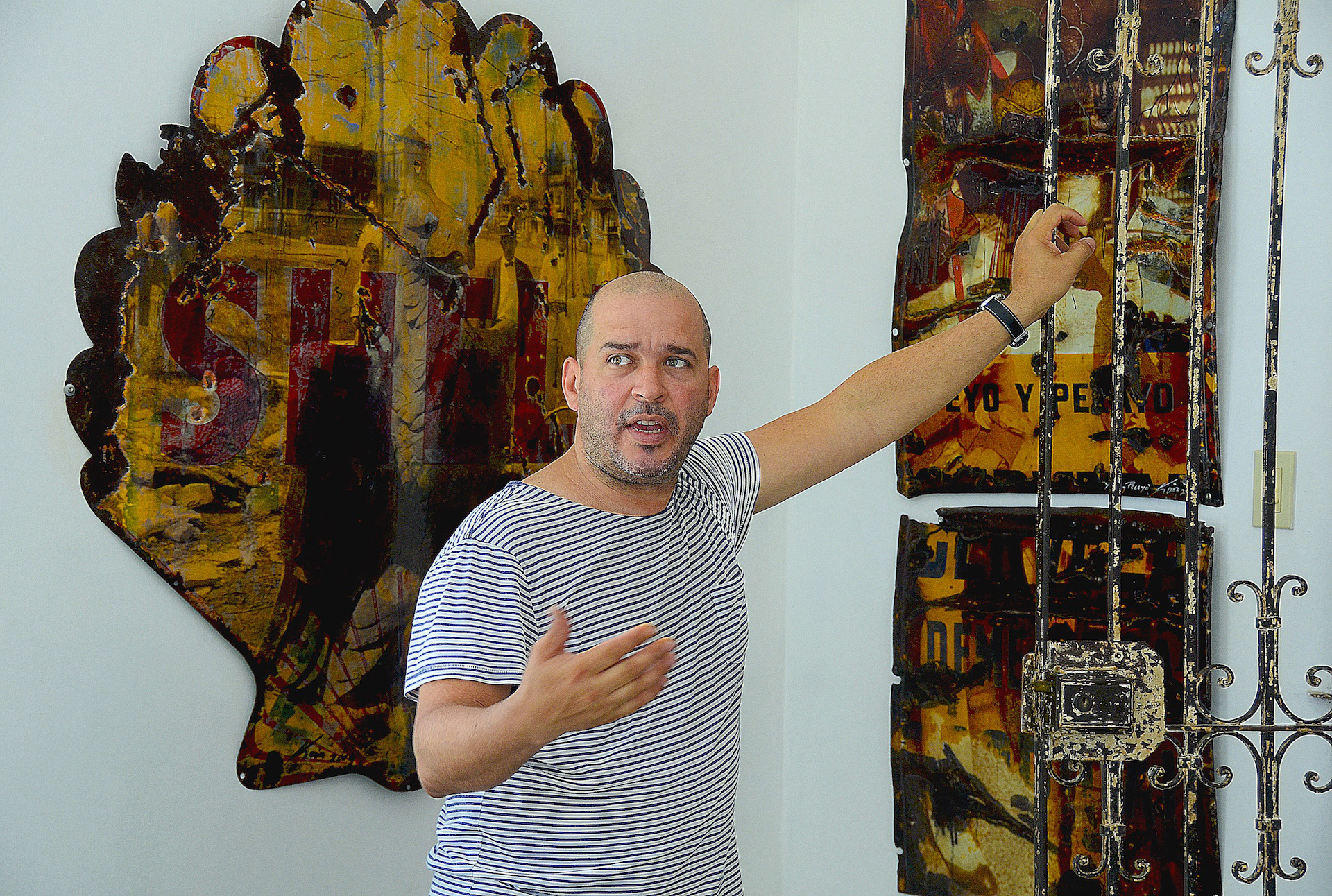 Artist in Cuba explains and showcases work for private studio visit as highlight of educational music and arts tour